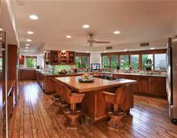Custom wooden features through out this open-style kitchen.