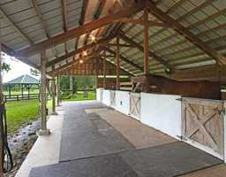 Well-lit and maintained outdoor stables.