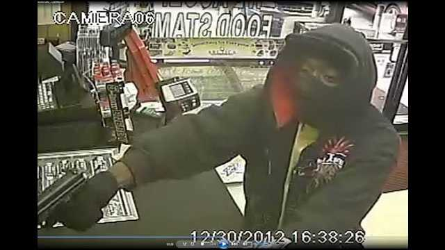 Deputies are looking for this gunman who robbed a Kwik Stop convenience store in West Palm Beach.