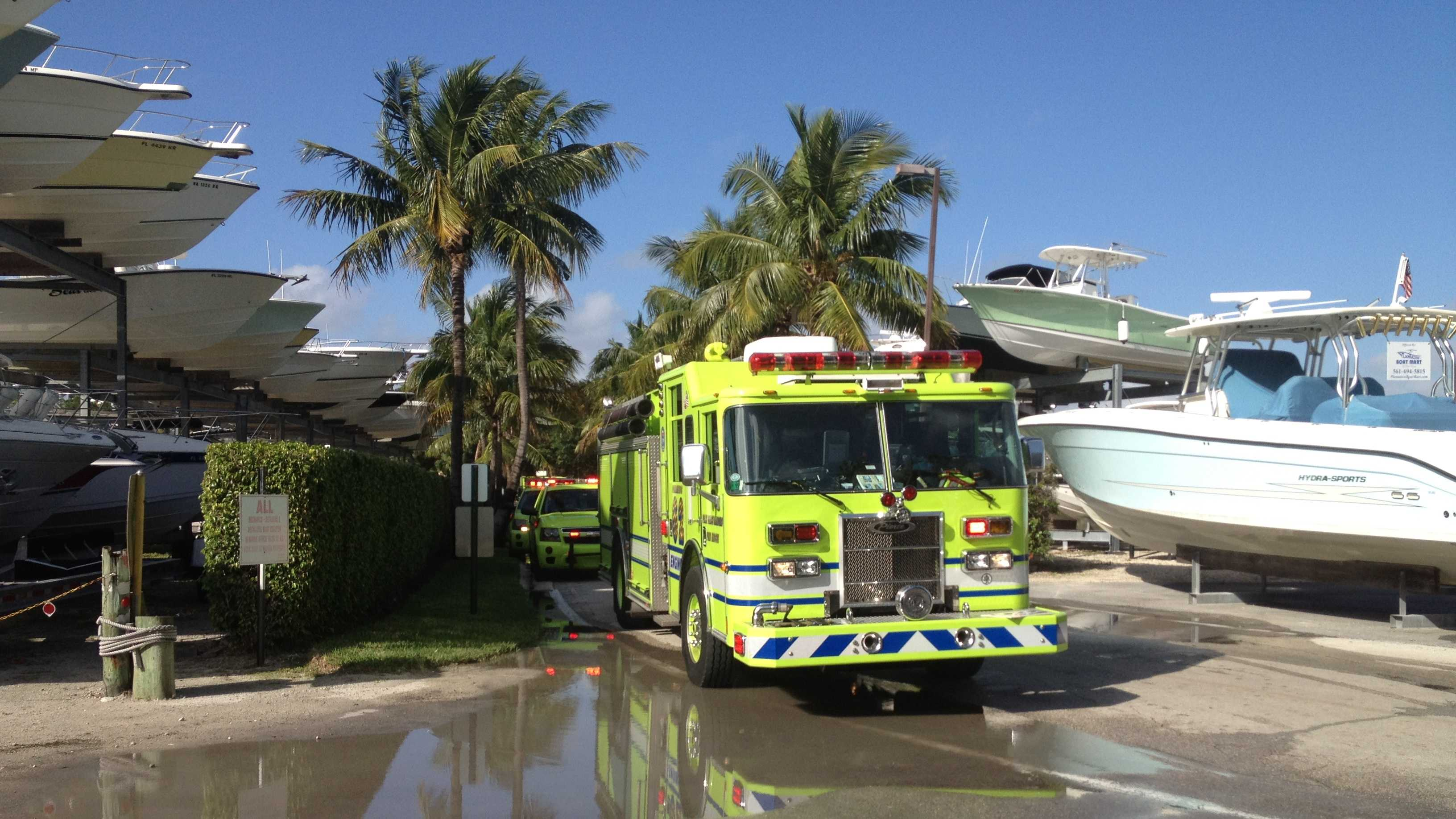 Firefighters are trying to determine what caused a small boat to explode at the PGA Marina.
