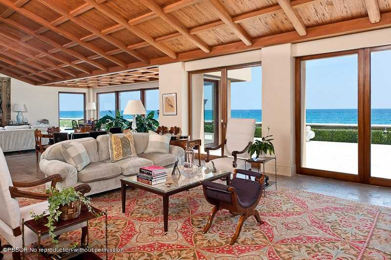 This home may resemble a Hawaiian estate but you're still in Florida. Classic, beachy decor make this room timeless.