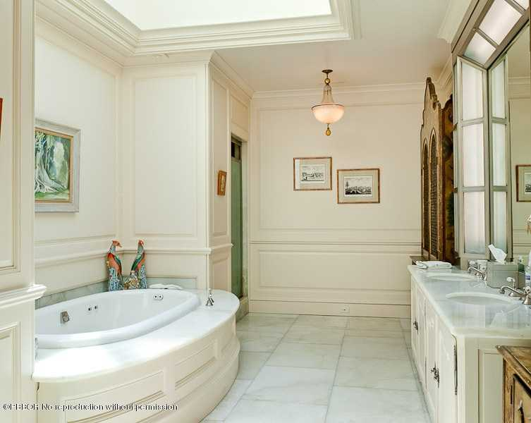 Master bedroom complete with a jacuzzi tub, private shower and his and her vanities.
