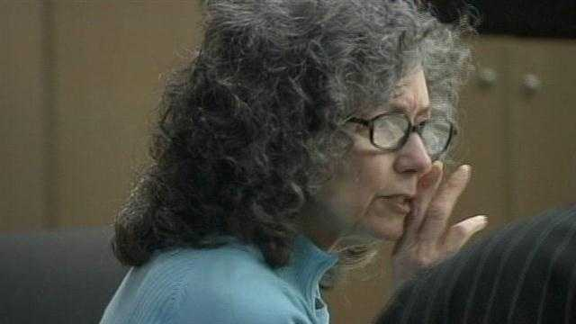 Donna Horwitz, who is on trial in the fatal shooting of her ex-husband, whispers to her attorney in court.