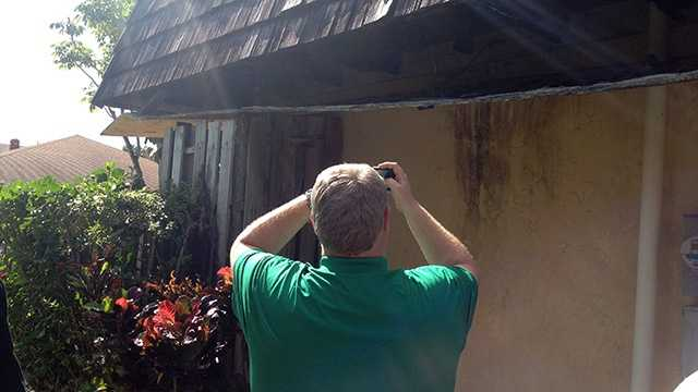 Chris Burnett surveys the damage at Rosemary Woodstock's home in West Palm Beach. His restoration company is going to fix it up for free. (Photo: Cathleen O'Toole/WPBF)