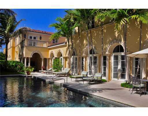 An exquisite pool area is also featured on this beach property. for information on this home, visit Realtor.com.