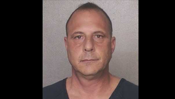 Broward Sheriff's Office Detective John Brindle was arrested on a drug charge.