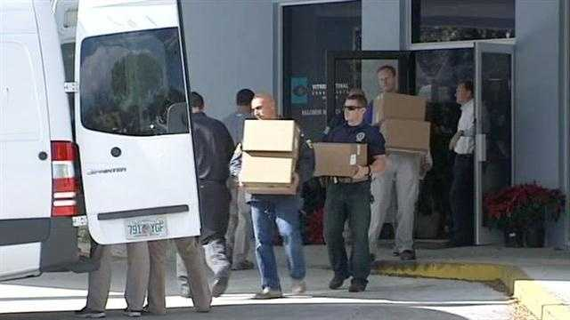 Federal agents remove boxes from Dr. Salomon Melgen's West Palm Beach office.