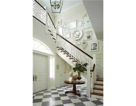 Exquisite foyer, featuring elegant white accents.