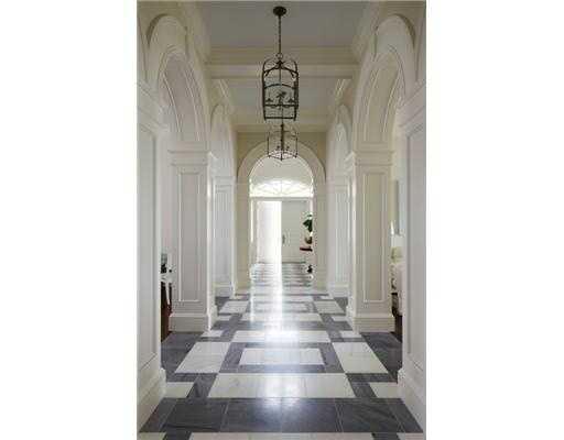 White columns/ archways grace the hallway.