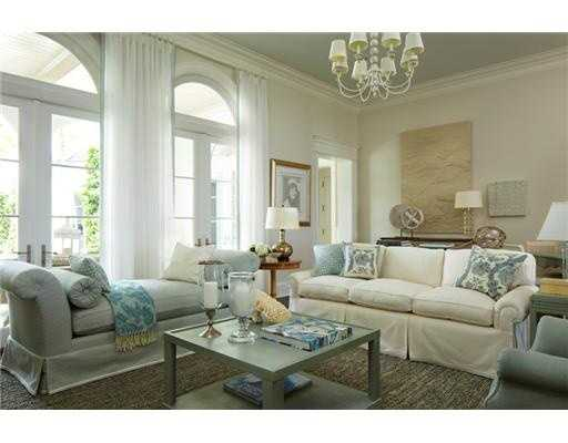 Comfortable couch and chaise inside of this casual family room.