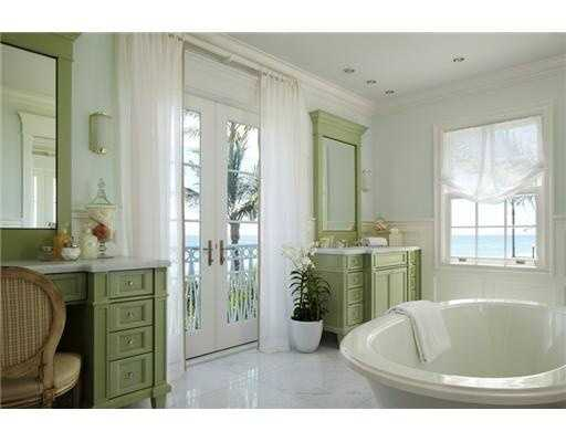 Beautiful bathroom in the master suite allows views overlooking the ocean from the bath tub.