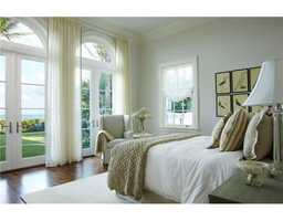 This guest room features beautiful french doors, providing direct access to the water.