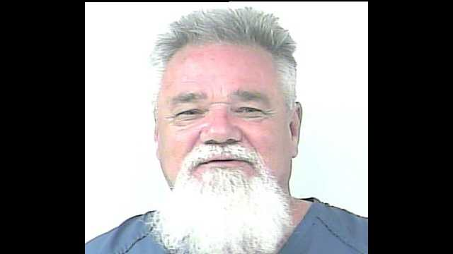 Paul Davis is accused of lying naked in the middle of Okeechobee Road in Fort Pierce on Tuesday.