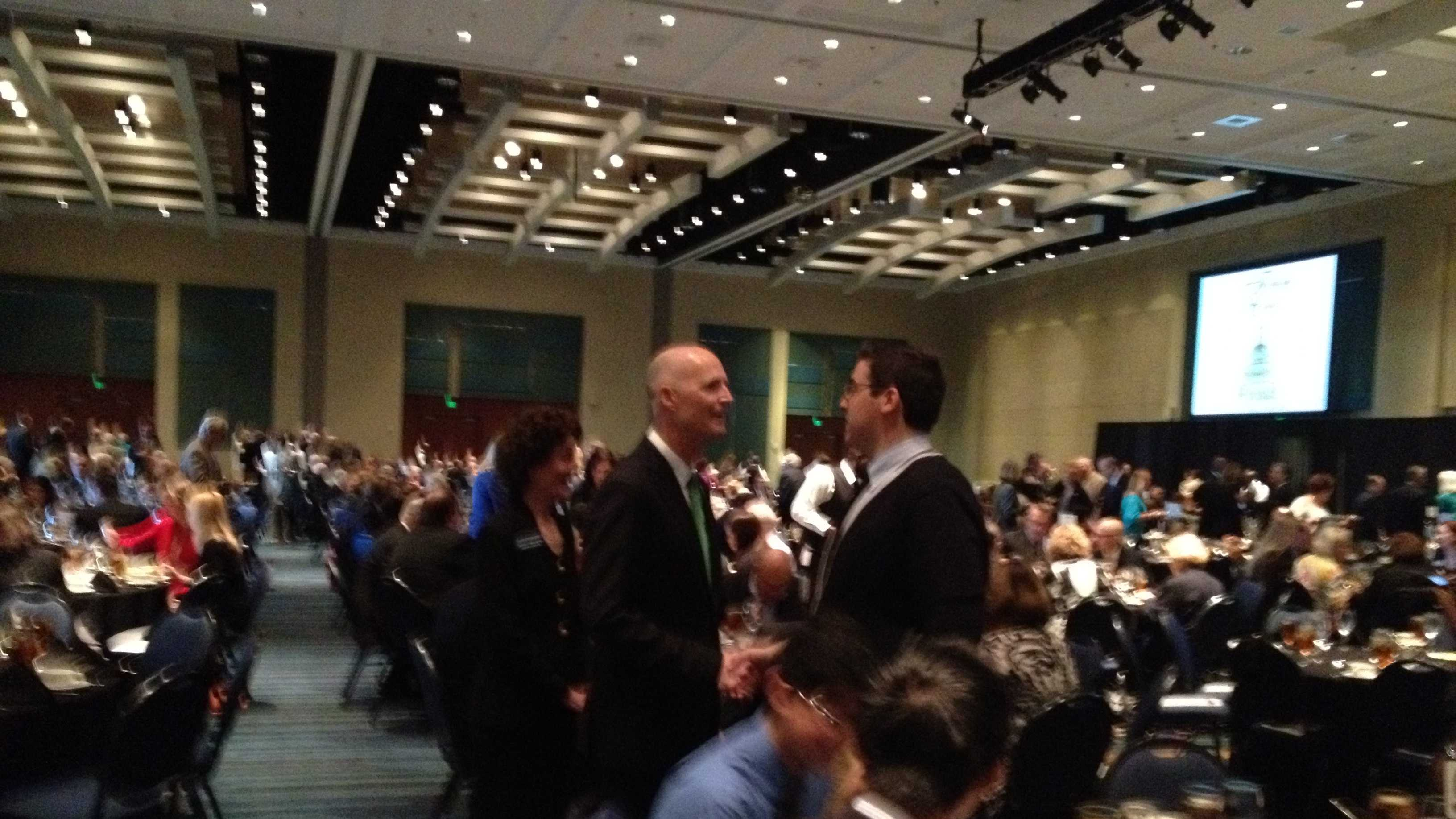 Gov. Rick Scott greets attendees at Monday's Forum Club luncheon in West Palm Beach.