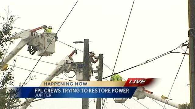 FPL workers try to restore power