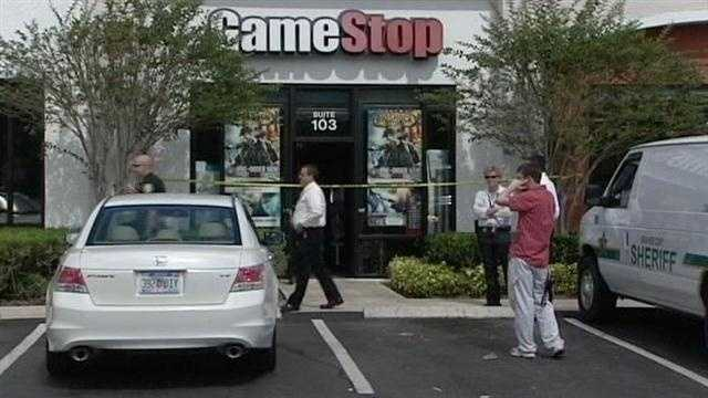 Detectives say two gunmen tied up an employee during a robbery at a Game Stop in Vero Beach.