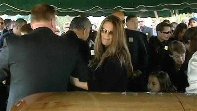 Loved ones and colleagues alike found it difficult to hide their emotions as Sgt. Gary Morales was taken to his final resting place four days after he was shot dead during a traffic stop.