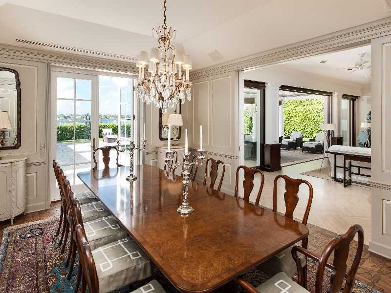 Formal dining room features not only a beautiful crystal chandelier but also exquisite views.