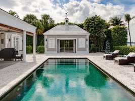Emerald green pool provides contrast to the neutral toned patio area.