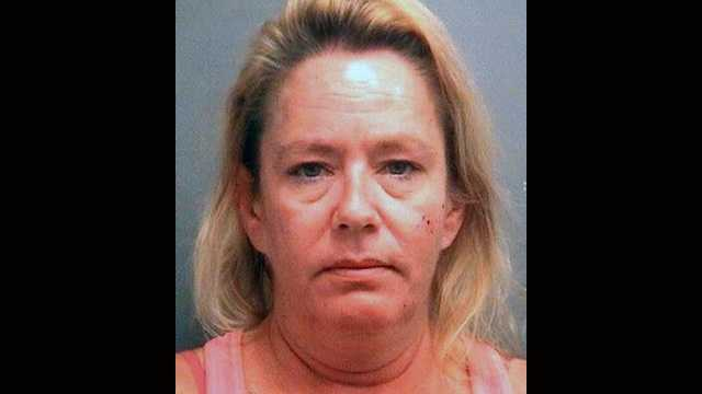 Julie Beers is accused of passing out behind a dumpster with her 5-year-old daughter with her.