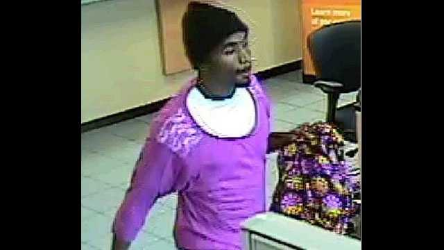 Bank robber dressed as woman