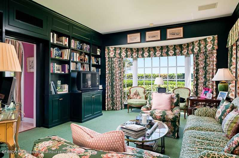 Comfortable living spacy featuring a gorgeous, green wall unit.