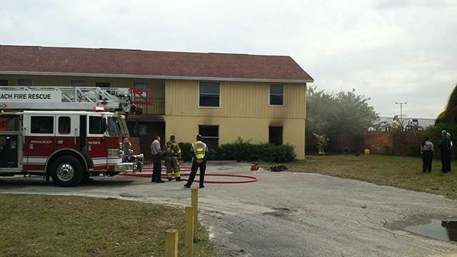 Fire damaged three units in a Riviera Beach apartment complex Tuesday afternoon. (Photo: Erin Guy/WPBF)