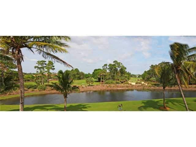 Plus, it overlooks the beautiful course at the Old Palm Golf Club.