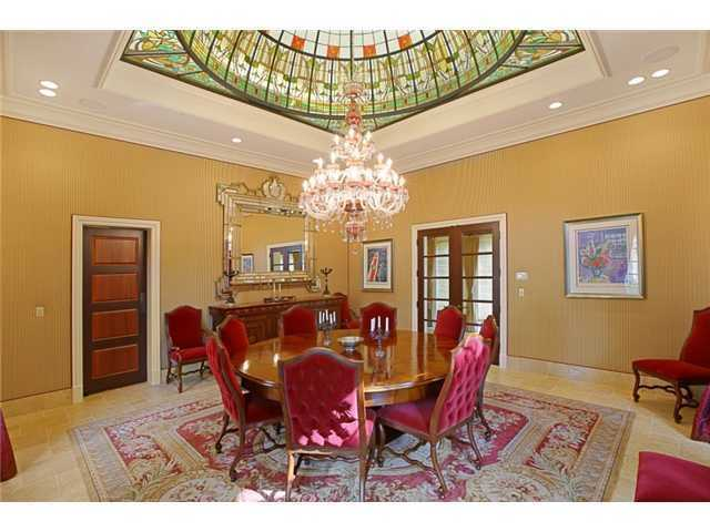 A stain-glass vaulted ceiling and spectacular chandelier transform a regular dining room into a romantic dining space.
