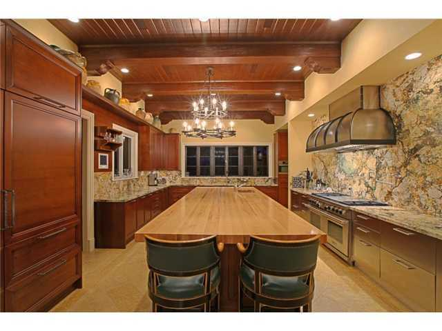 Beautifully designed kitchen has country taste but is complete with modern, professional appliances.