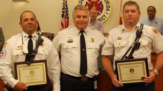 Lt. Christopher Longo (left) and Lt. Steven Burns (right) were recently honored after saving a boy from a burning home. St. Lucie County Fire District Chief Ron Parrish (center) presented the firefighters with the Chief's Award of Excellence.