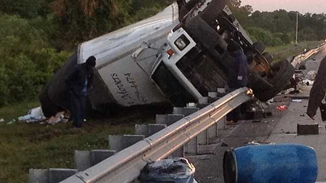 No one was injured when this tractor-trailer rolled over a guardrail on Florida's Turnpike during the Wednesday morning commute near the Martin County/Palm Beach County line.