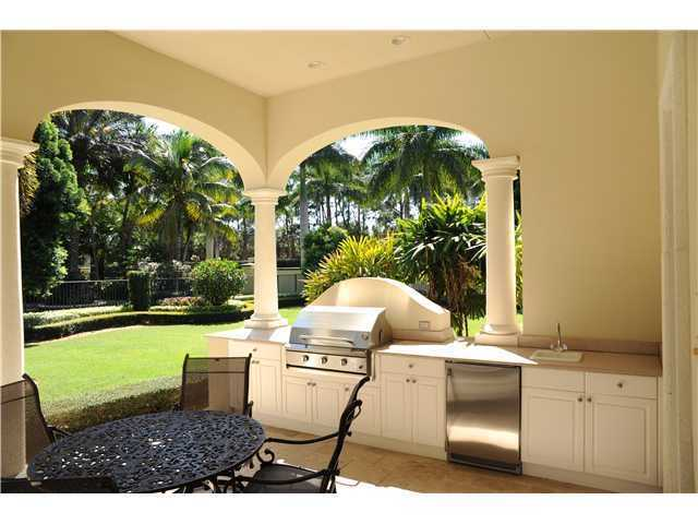 Custom cabana for entertaining and dining in the private doors.