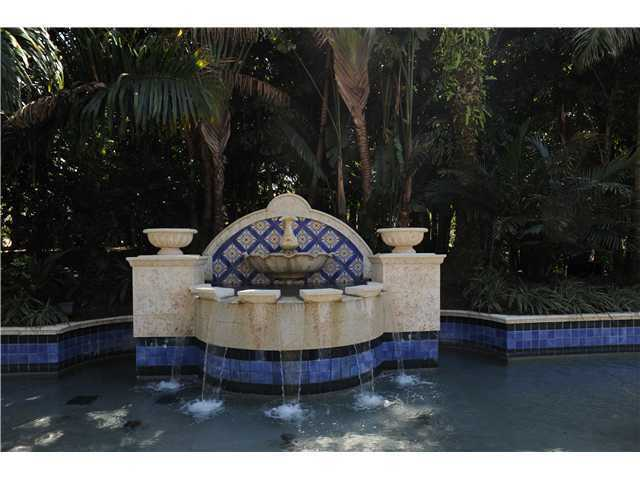 A beautiful fountain overflows into the pool.