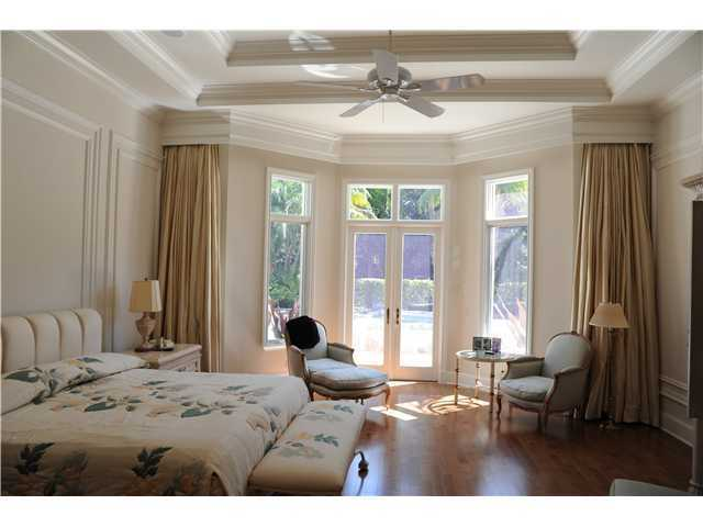 Master bedroom is one of 4 bedrooms in the home and provides private access to the pool.