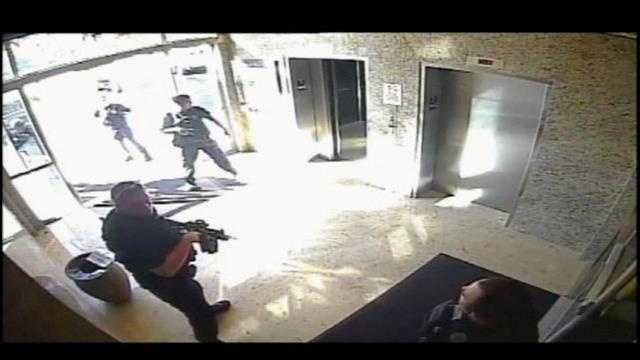 Surveillance video was released of the tense moments when a SWAT team converged on a Boca Raton office building following a murder-suicide there this week.