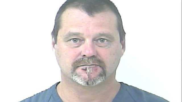 Dean Bair is accused of pulling a gun and yelling racial slurs at the driver who cut him off.