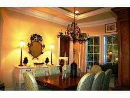 Formal dining room has plenty of timeless, Floridian influence.