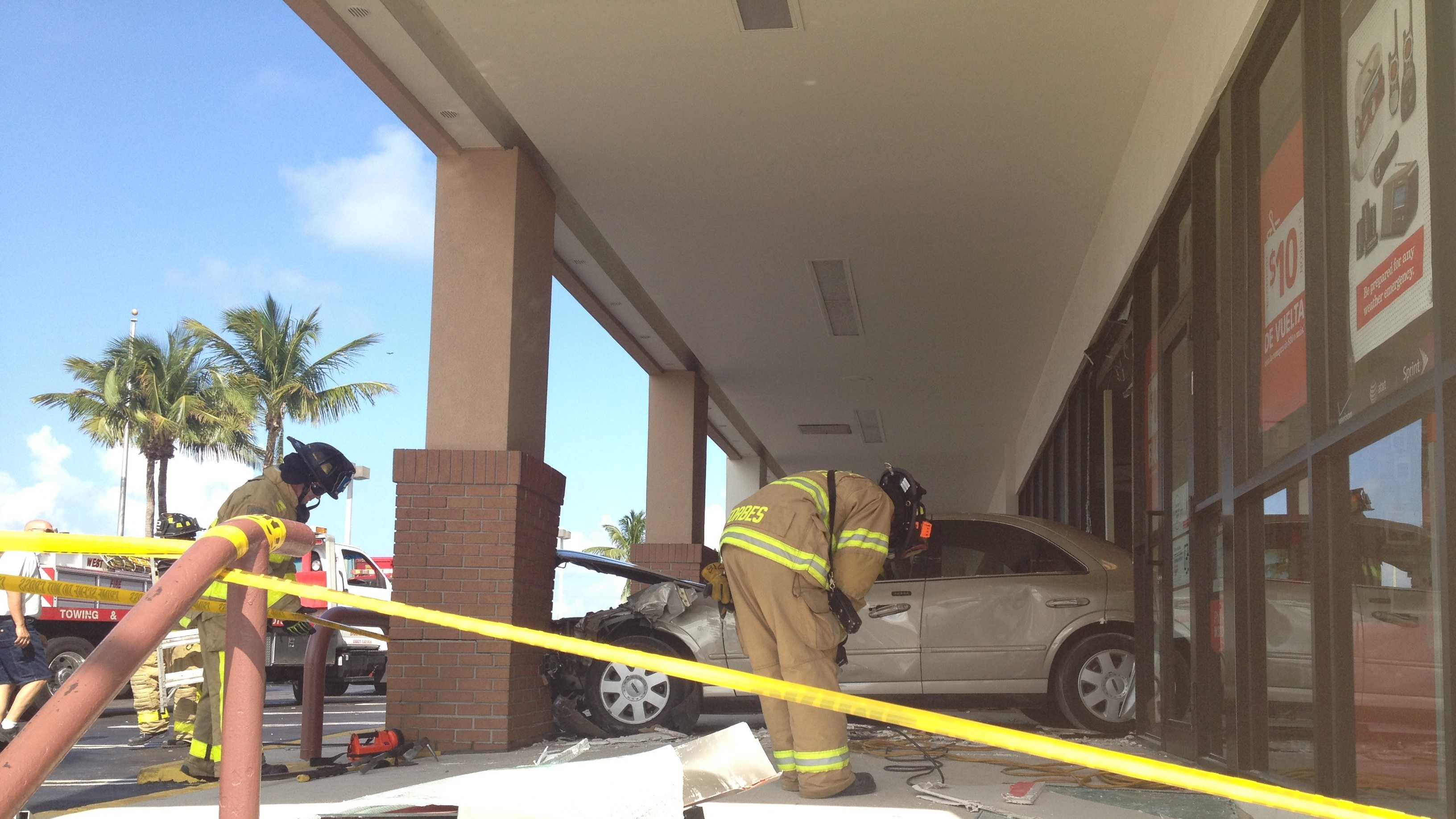 An elderly woman accidentally put her car in reverse and backed into this building in West Palm Beach.
