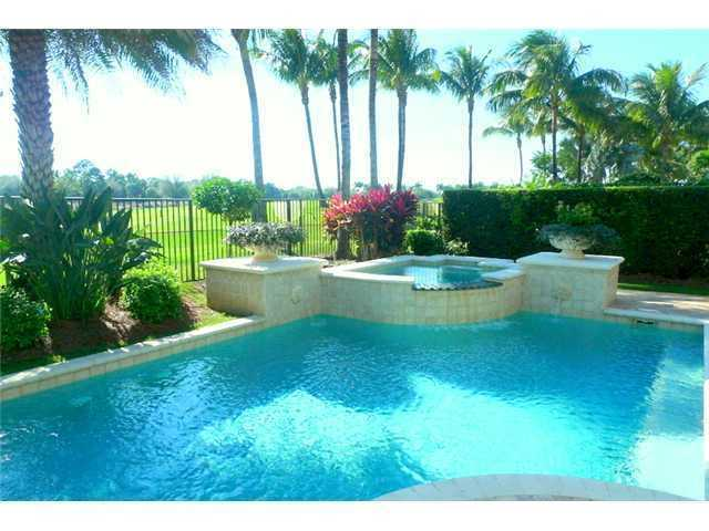 Gorgeous pool overlooks the golf course.