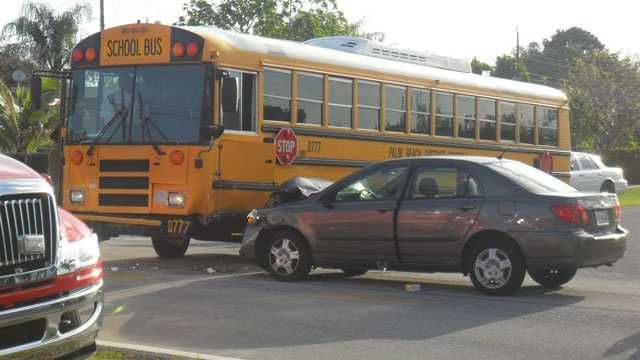 No students were injured when this school bus and car collided.