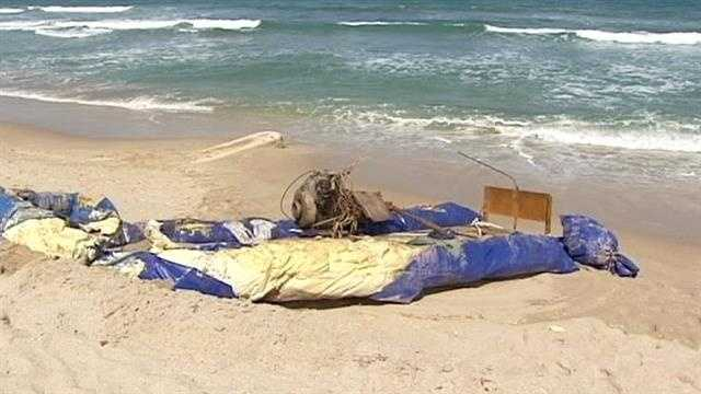 A mystery boat washes ashore in Gulf Stream, its final leg on a long journey.