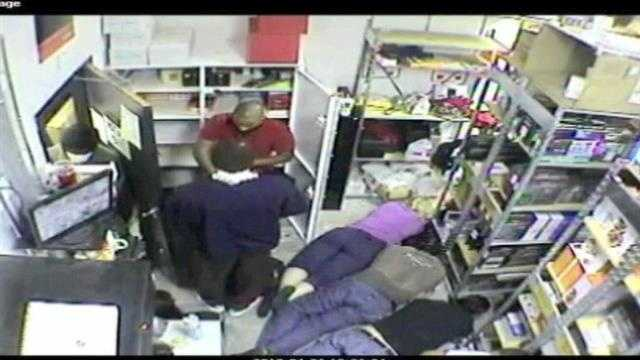 Two robbers hold customers and employees at a Port St. Lucie Radio Shack at gunpoint.