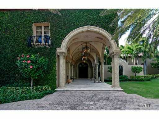 This entrance is immersed by lush vines and marble archways.