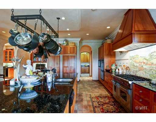Spacious kitchen measures 24 x24, and features functional, yet stylish amenities to make any chef happy.