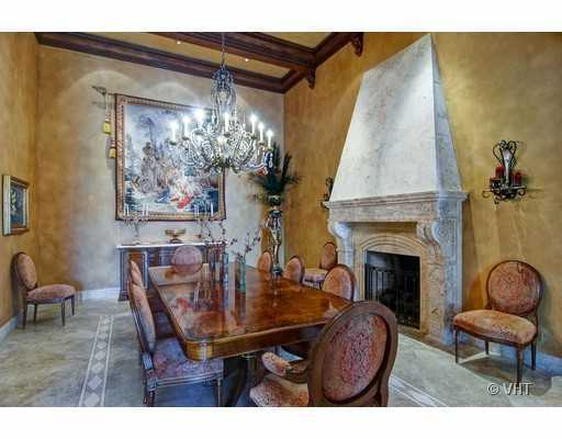 The formal dining room features a beautiful stone fireplace.