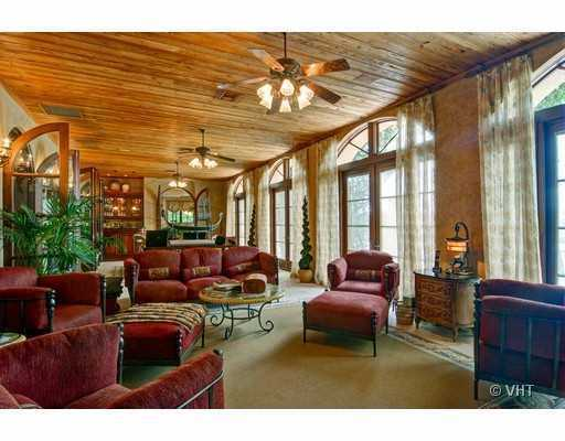 Sun room features a wooden ceiling and grand french doors to allow plenty of natural sunlight.