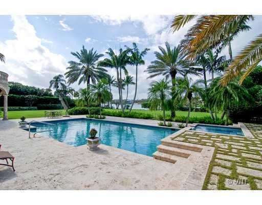 Experience relaxation and privacy on this pool deck overlooking the calm Hube Sound.