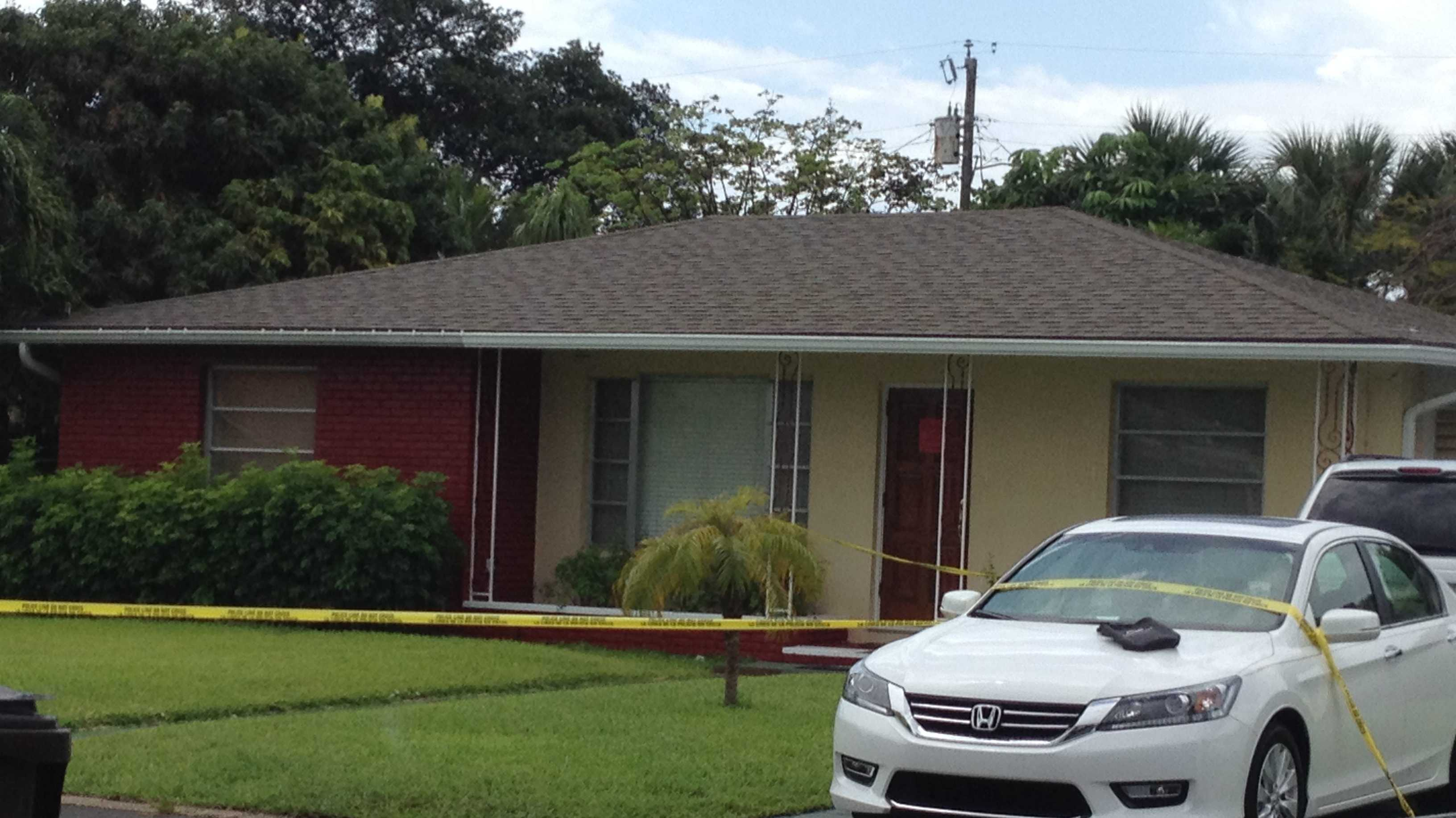 Police and DEA agents are seen going in and out of a West Palm Beach home where a man was severely burned.