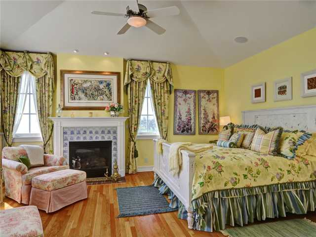 This bedroom also has a fireplace. The home has four bedrooms in total.
